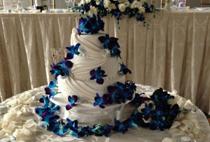 cake decoration with blue singapore orchid and rose petals