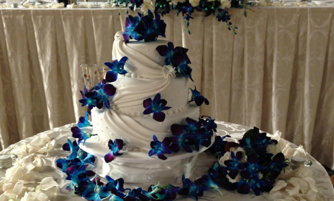 Wedding Cake Decoration Singapore With Blue Orchid And Rose Petals